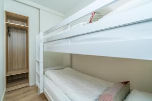 Ein Etagenbett oder Etagenbetten in einem Zimmer der Unterkunft De Herberg Appartementen