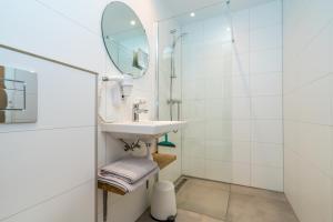 Een badkamer bij De Herberg Appartementen