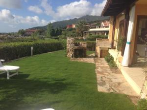 A garden outside Villa Erika Is Molas mare golf