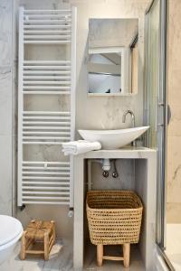 Um banheiro em My Maison In Paris - Sentier