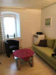 A seating area at Gemütliches Appartement nähe Zentrum mit Küche