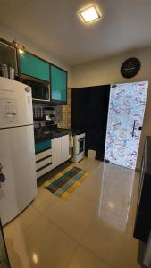 A kitchen or kitchenette at Apto Boulevard Manaus - RARIDADE