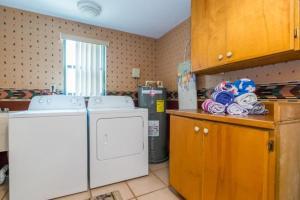 A kitchen or kitchenette at Azure Seas Three Bedroom Villa