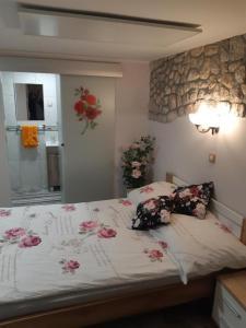 Postelja oz. postelje v sobi nastanitve Apartment Tarman