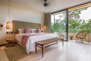 A bed or beds in a room at Copal Tulum Hotel