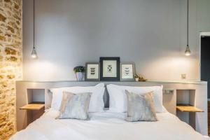 Un ou plusieurs lits dans un hébergement de l'établissement Manoir du Moulin