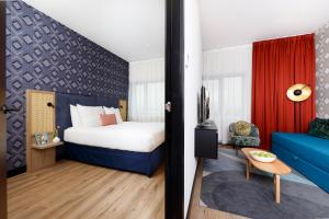 A bed or beds in a room at Boutique Apartments Amsterdam