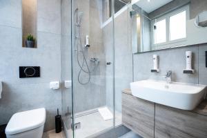 A bathroom at Aparthotel by dP