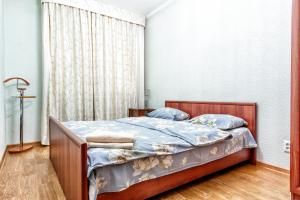 A bed or beds in a room at Уютная квартира в центре. Cozy apartment in the city center. 422