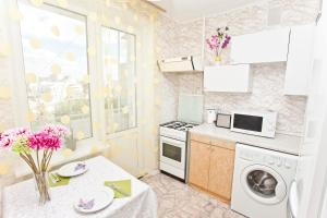 A kitchen or kitchenette at Serviced Apartments Belorusskaya - Moscow