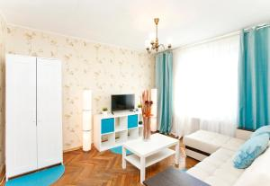 A television and/or entertainment center at Serviced Apartments Belorusskaya - Moscow
