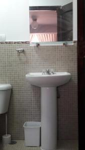 Un baño de Wasinkayka Aparts & Rooms