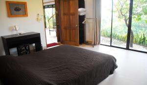 A bed or beds in a room at Argonauta Boracay Apartment Suites and Villas