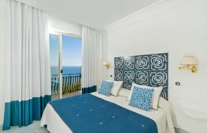 A bed or beds in a room at Positano Luxury Villas