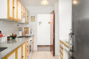 Una cocina o kitchenette en Tu Apart En Bariloche 2