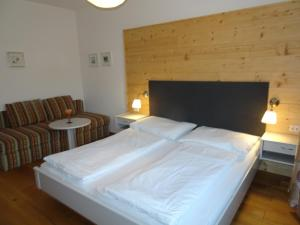 A bed or beds in a room at Schlossalm Appartement
