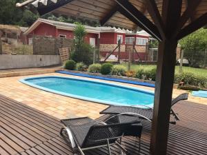 The swimming pool at or near Chale Gramado Lazer e Piscina