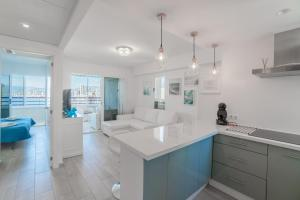 A kitchen or kitchenette at TROPIC MAR Levante beach apartments