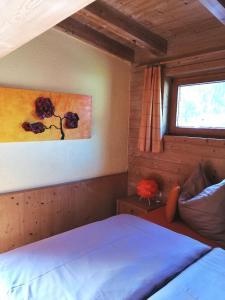 Ein Bett oder Betten in einem Zimmer der Unterkunft Apartment Hausberger