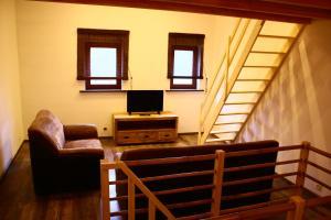 A television and/or entertainment centre at maison neuve en bois près de Pairy Daisa