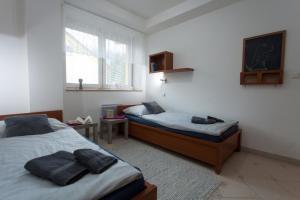 Posteľ alebo postele v izbe v ubytovaní Apartmán Tatran Donovaly Deluxe