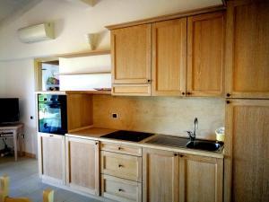 A kitchen or kitchenette at Punta Falcone Resort