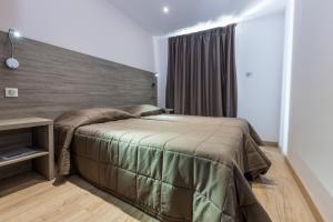 Cama o camas de una habitación en Residence Club Marina Viva