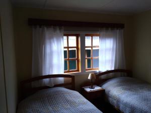 A bed or beds in a room at El Colono