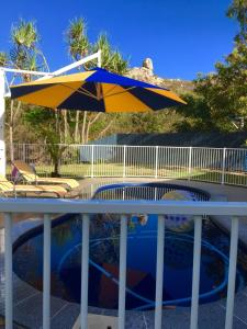 The swimming pool at or near Golden Sands Beach House
