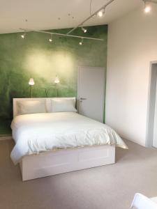 Ein Bett oder Betten in einem Zimmer der Unterkunft Oppenheim Lofts