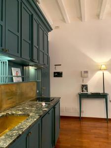 A kitchen or kitchenette at Corso Garibaldi Suite
