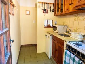 Una cocina o kitchenette en Reina Mariana