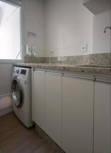 A kitchen or kitchenette at Veneza apartment