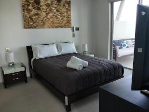 A bed or beds in a room at Trilogy Surfers Paradise
