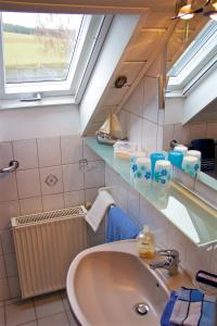 حمام في Ferienwohnungen Engelsgaertchen