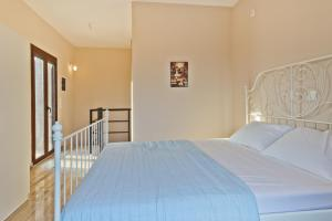 A bed or beds in a room at Petra Villas