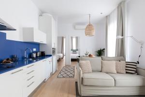 A kitchen or kitchenette at Aspasios Verdi Apartments