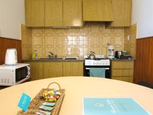 A kitchen or kitchenette at Casa Buena Vista Tandil