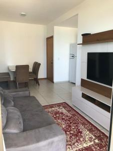 A television and/or entertainment centre at 704 - Itaparica exclusive