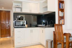 A kitchen or kitchenette at Sofi Apartment at Jayakarta Residence