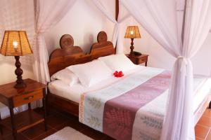 Ein Bett oder Betten in einem Zimmer der Unterkunft La Villa Mille Etoiles