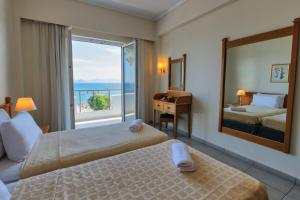A bed or beds in a room at Kos Hotel Junior Suites