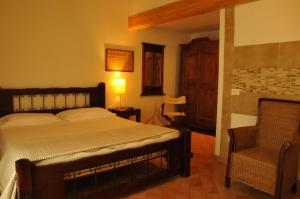 A bed or beds in a room at Caterina Residence