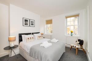 Ein Bett oder Betten in einem Zimmer der Unterkunft Betterton - WC2H