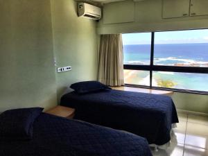 A bed or beds in a room at Ondina Apart Hotel - Vista Mar