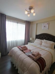 Cama o camas de una habitación en Yoned's Apartment I