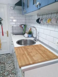 Küche/Küchenzeile in der Unterkunft Coqueto estudio en la playa