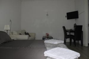 Ein Bett oder Betten in einem Zimmer der Unterkunft slijterij-zandvoort