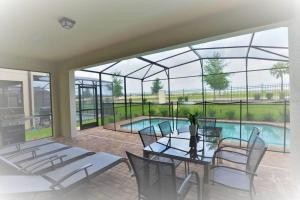 The swimming pool at or close to Simply Comfort - Fantastic 5Bd House,Private Pool,Disney,Orlando