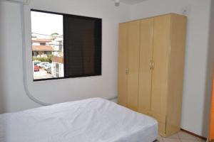 Cama o camas de una habitación en Apartamento nos Ingleses. Ótima Localização